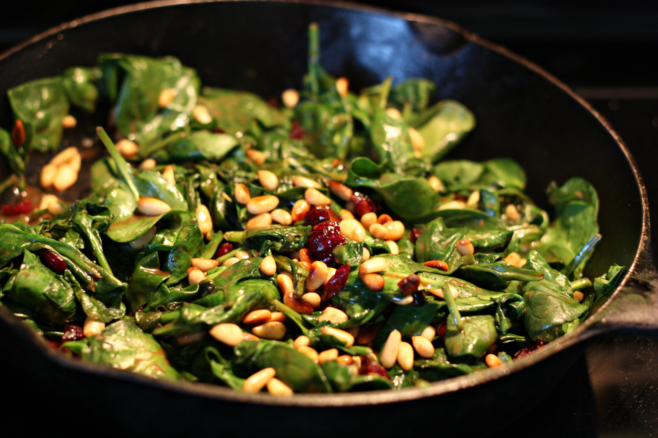Hot Spinach Salad in a skillet via Nest of Posies