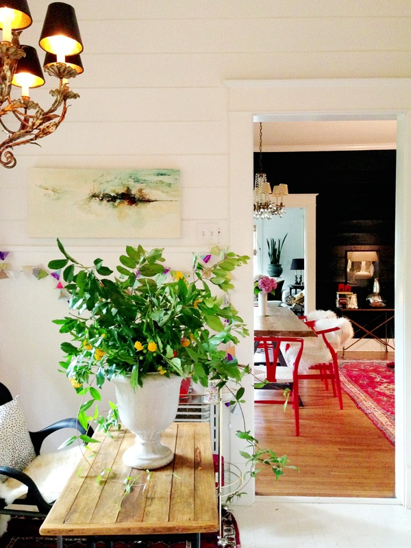White walls.  With one dramatic black wall.  Pops of color & natural elements
