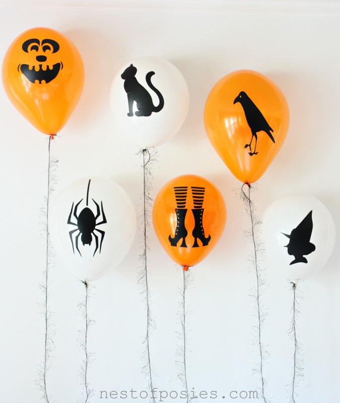 DIY Halloween Silhouette Balloons.  Fun for parties & for the kids to decorate!  via Nest of Posies