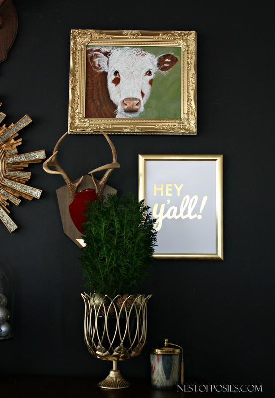 Black Gallery Wall with Antlers and Cow Painting