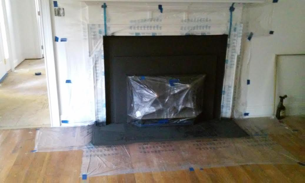 Before and After of a Wood Burning Insert Fireplace Makeover using high heat spray paint. The wood burning insert fireplace makeover truly shines.