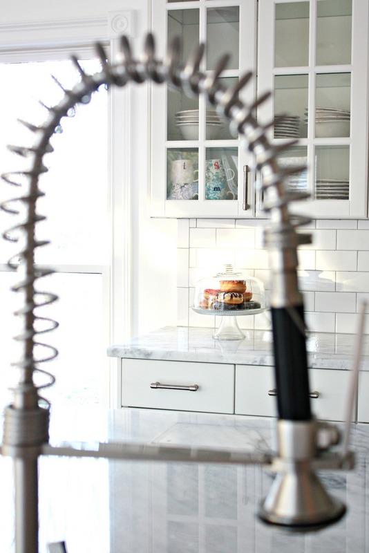 All white kitchen with Subway tile backsplash