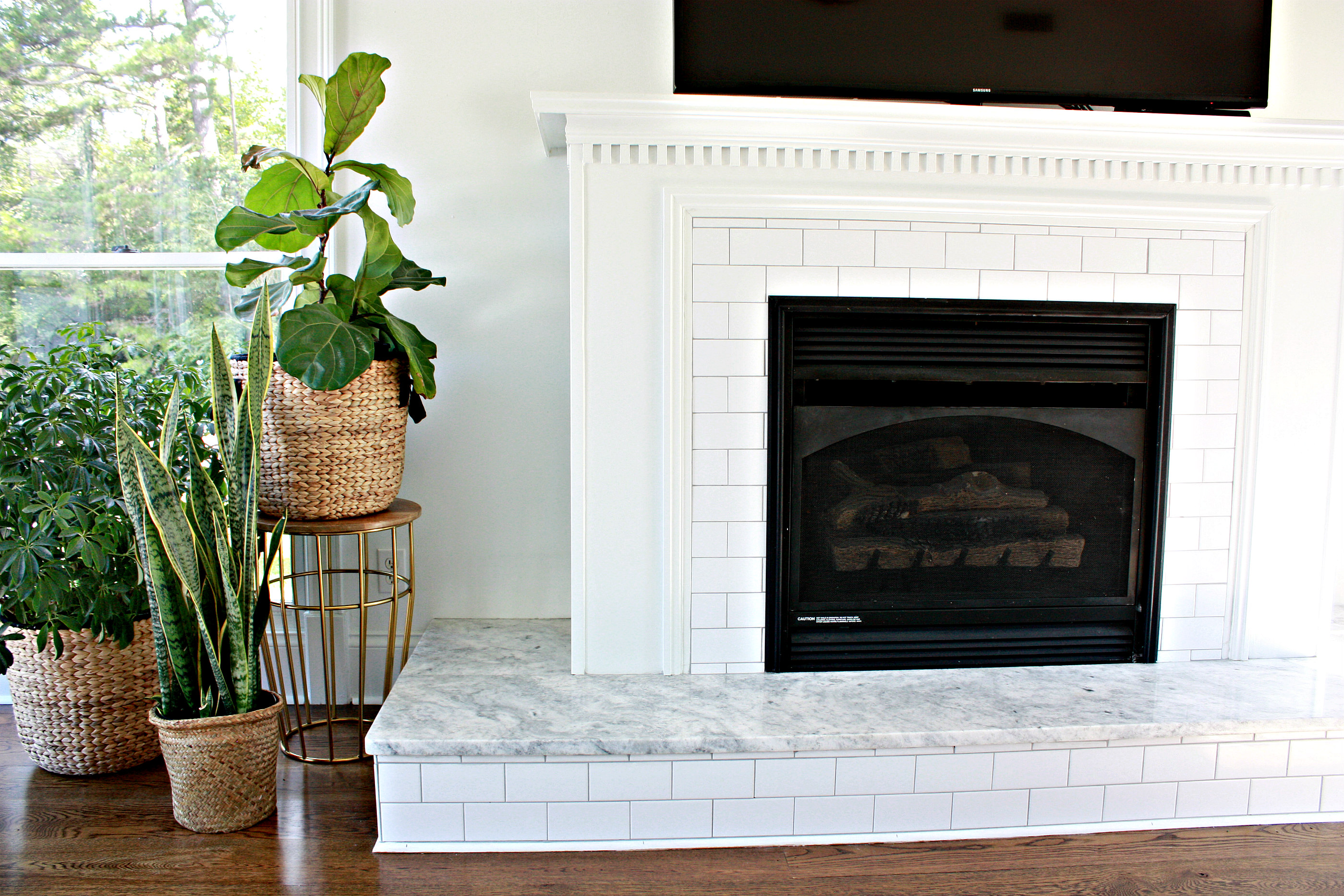Fireplace With Subway Tile And Carrera Marble Nest Of Posies